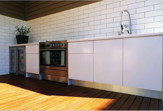 White Outdoor Kitchen with subway tiles